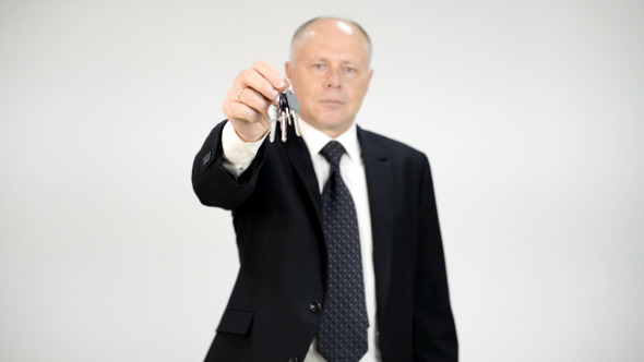 Businessman Giving Keys