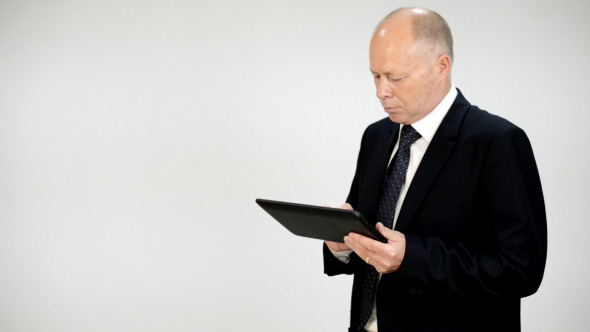 Businessman Typing on Tablet PC