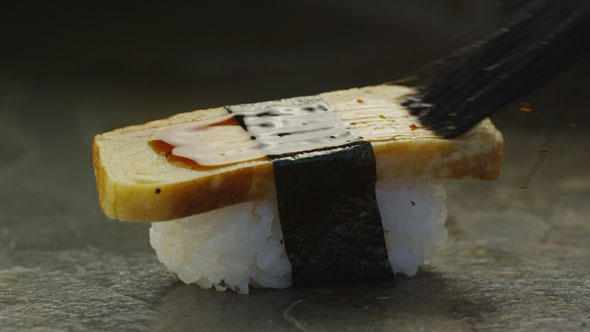 Chef Preparing Sushi with Tamago in Restaurant