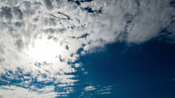 Clouds Moving In The Blue Sky On The Background Of