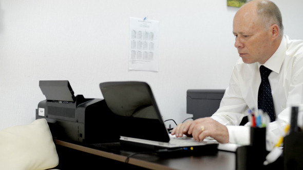 Working in Office on Laptop