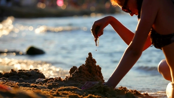 Girl On The Sea Builds a Sand Castle