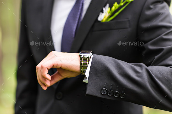 young business man  looking at watch over white background - Stock Photo - Images