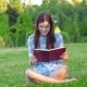 Beautiful Girl With Book In The Park - VideoHive Item for Sale