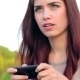 Young Woman In Park Texting On The Phone - VideoHive Item for Sale