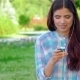 Beautiful Girl In Park With Her Phone/player - VideoHive Item for Sale
