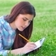 Beautiful Girl With Her Diary In Park - VideoHive Item for Sale