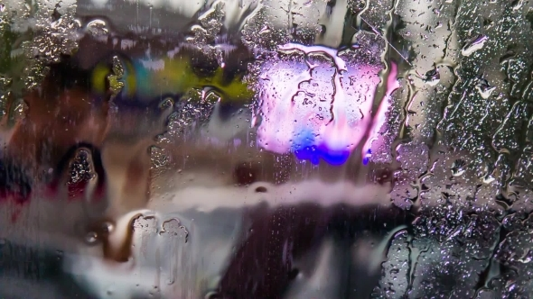 Rain Drops Flowing On Car Glass