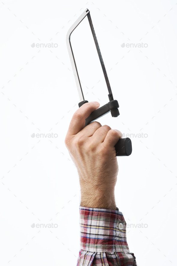 Hand holding an hacksaw - Stock Photo - Images