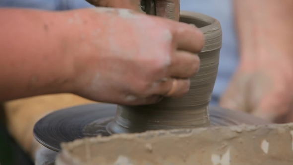 Women's Hands Making Ceramic Cup On Potter's Wheel