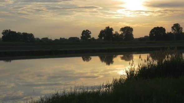 Pond River Lake Sunset Reflection