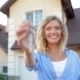 Happy Girl With Keys Next To Her New House - VideoHive Item for Sale