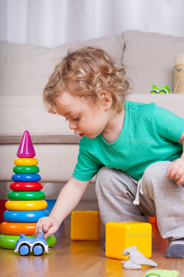 Boy playing with toys - Stock Photo - Images