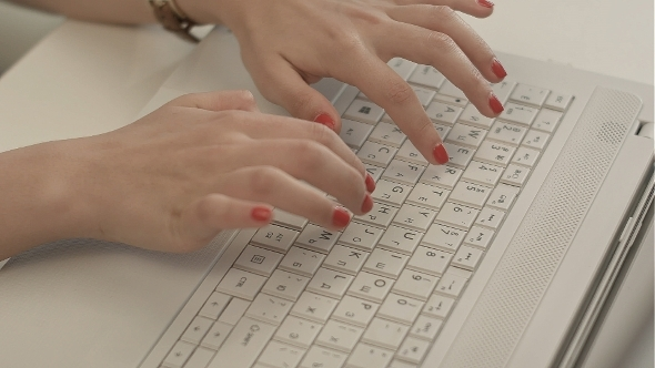 Woman Hands On The Keyboard