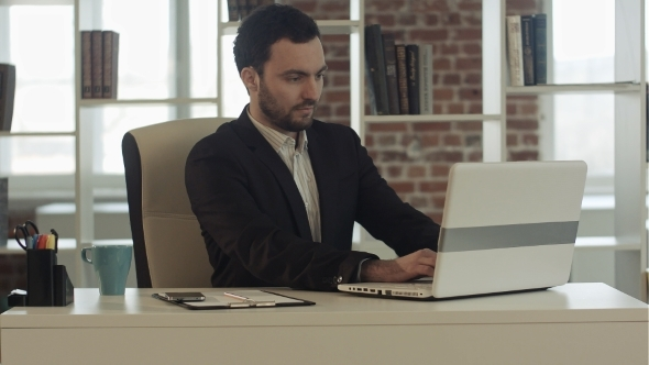 Young Businessman Start Working With a Laptop