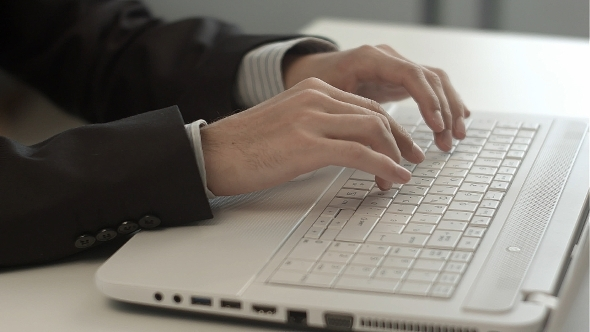 Man's Hands Typing On Keyboard Notebook