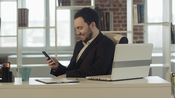 Happy People With Businessman On The Phone Typing