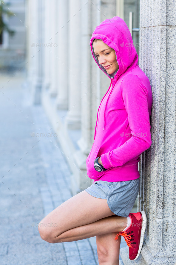A woman wearing a pink jacket on a sunny day - Stock Photo - Images