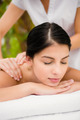 Attractive woman receiving back massage at spa center - PhotoDune Item for Sale