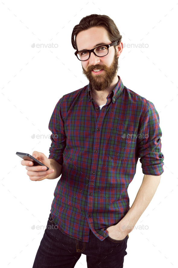 Handsome hipster using his phone on white background - Stock Photo - Images