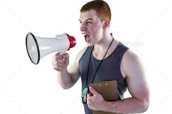 Personal trainer yelling through the megaphone on a white background - Stock Photo - Images