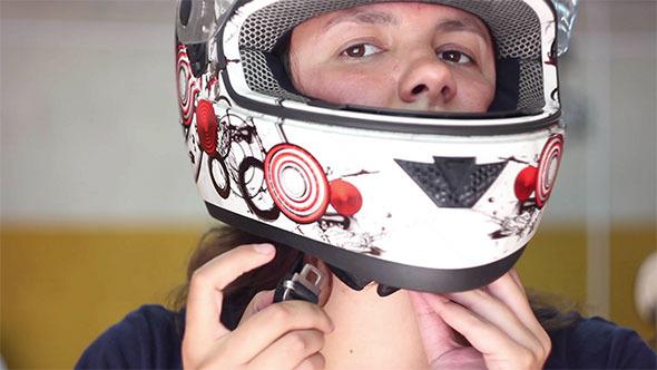Woman Put on Helmet and Fasten it