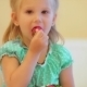 Adorable Little Girl Eating Strawberries - VideoHive Item for Sale