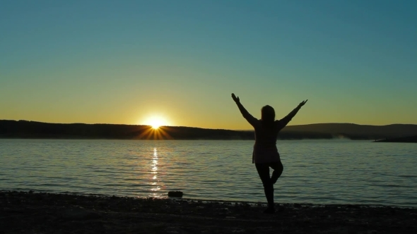 Pregnant Woman At Dawn Doing Exercise