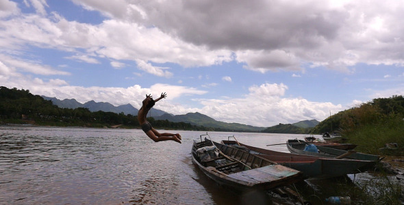 Boy Jumping From A Boat