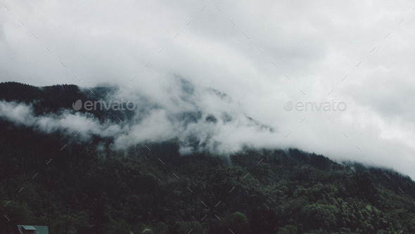misty mountains with lush green hills - Stock Photo - Images