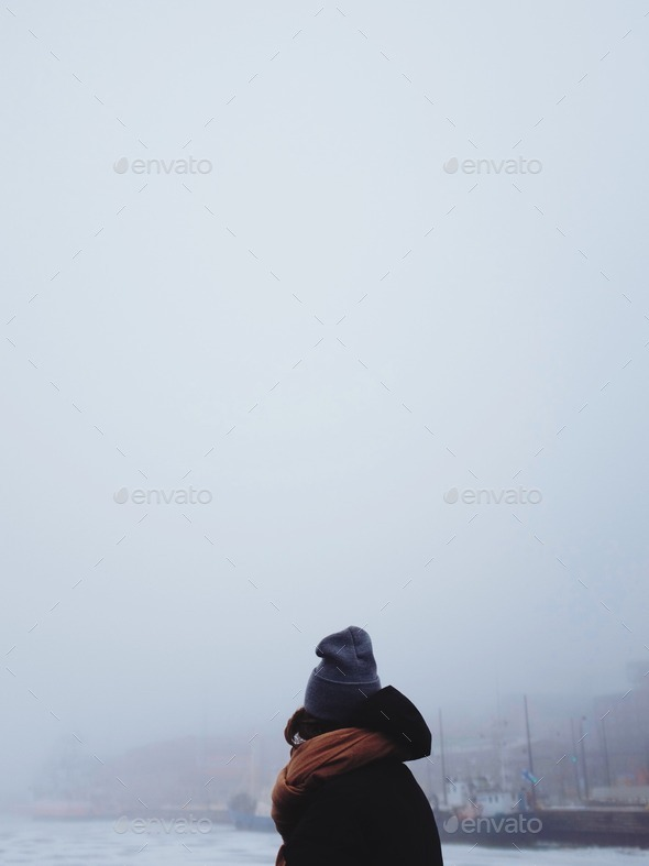 Woman framed agains a foggy sea view - Stock Photo - Images