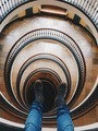 picture of legs dangling from tall spiral building - PhotoDune Item for Sale