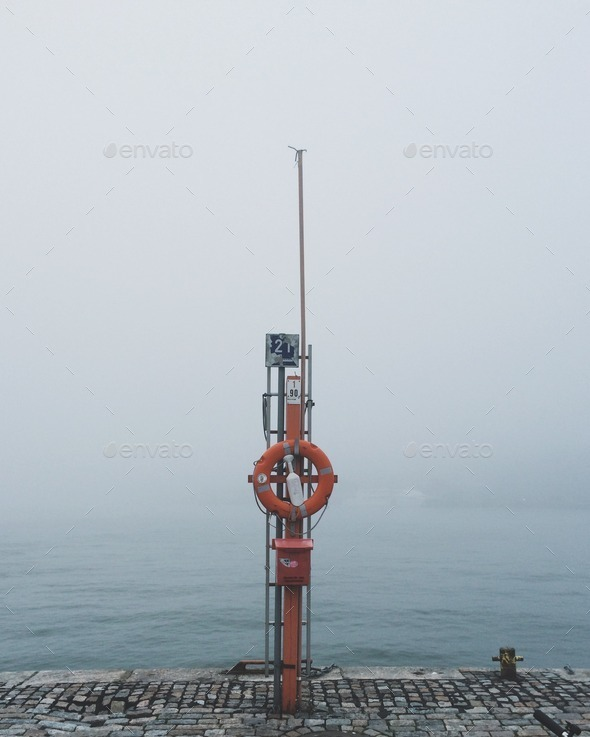 Sea view on a foggy day with sailing accessories - Stock Photo - Images