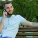 Smiling Handsome Man Talking On The Phone In Park - VideoHive Item for Sale