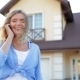 Beautiful Girl Talking On Phone Next To New House - VideoHive Item for Sale