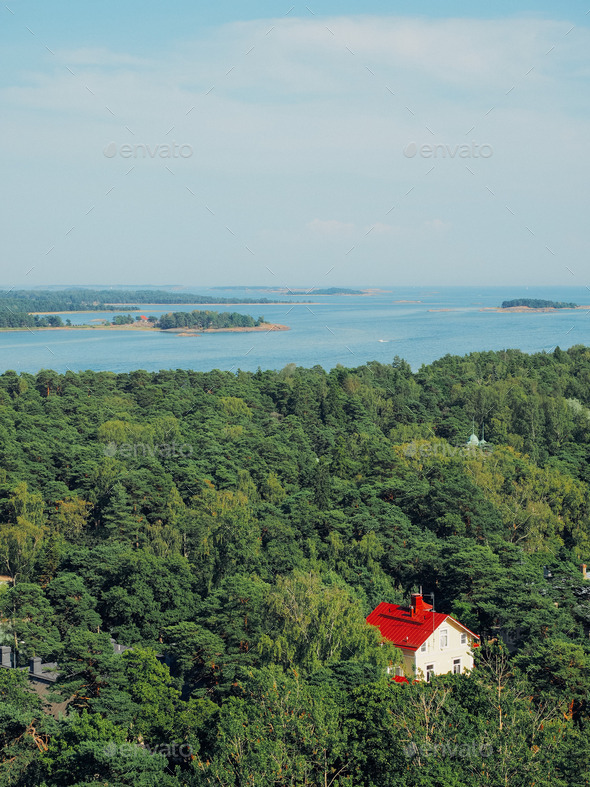 Shot of finnish archipelago and a red house - Stock Photo - Images