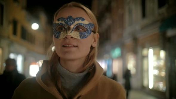 Woman In Carnival Mask Walking In Venice Italy