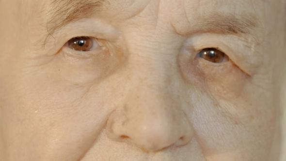 Senior Woman Opening And Closing Eyes