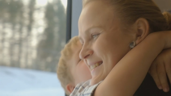 Little Child Embracing Mother In Train