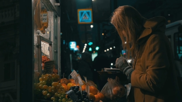 Woman Buying Fruit In Street Stall