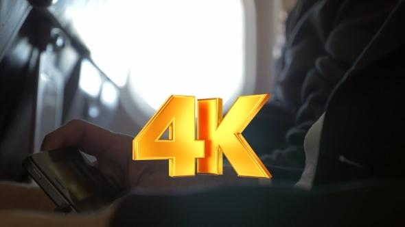 Man Watching Movie On Smart Phone In Plane