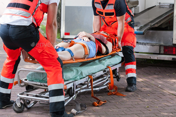 Woman after accident on the stretcher - Stock Photo - Images