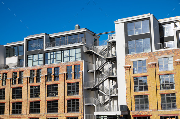Flats in an old industrial building - Stock Photo - Images
