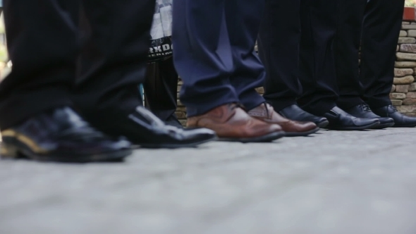 Men's Legs In Shoes On The Street