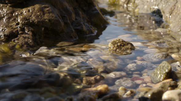 Water Flowing Through Stones