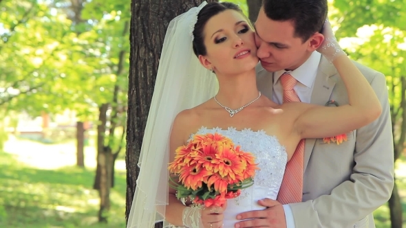 Newlyweds In A Park