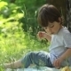 Little Boy Eats In Nature - VideoHive Item for Sale