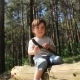 Boy Sitting On a Log - VideoHive Item for Sale