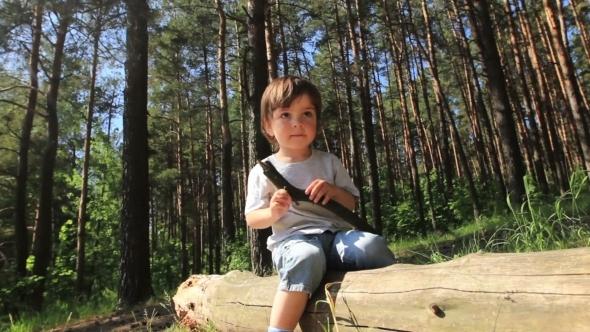 Boy Sitting On a Log