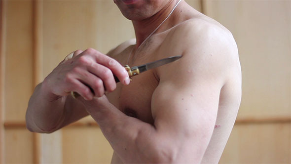 Muscle Man Following Arm by Knife